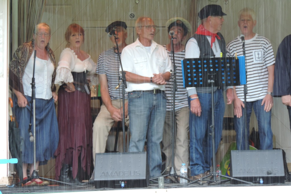 20th July - torrential rain - but the band played on!